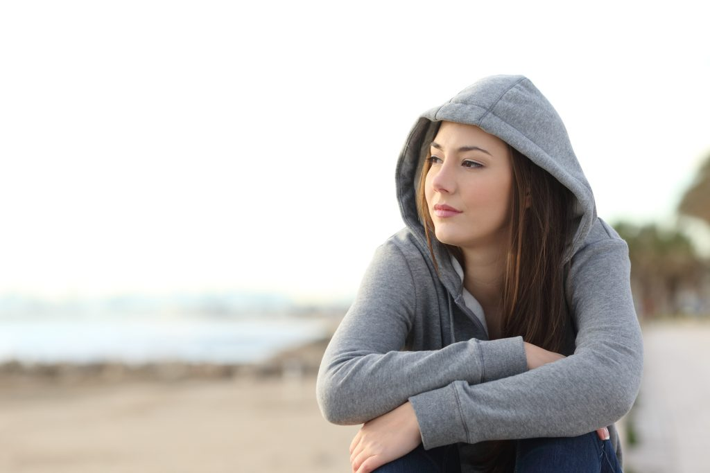 Longing pensive teenager looking away